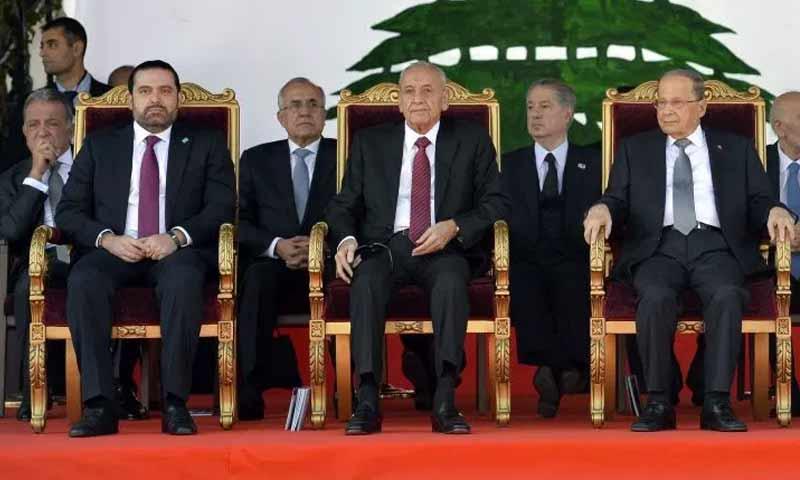 الرؤساء ميشيل عون ونبيه بري وسعد الحريري في عيد الاستقلال 33 للبنان (EPA)