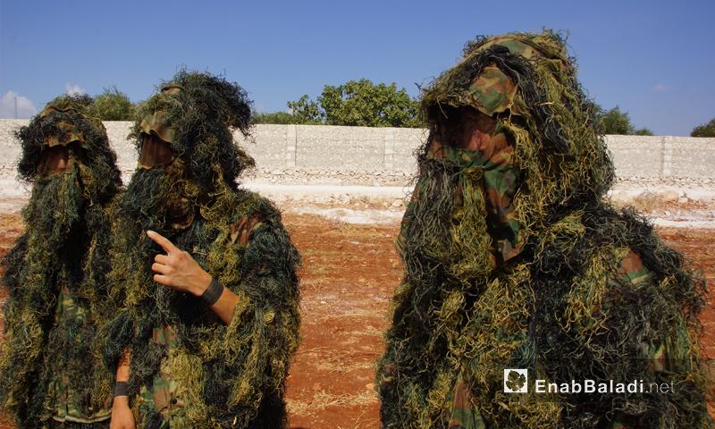 عناصر من فصيل جيش النصر في أثناء معسكر تدريبي بريف حماة - تموز 2018 (عنب بلدي)