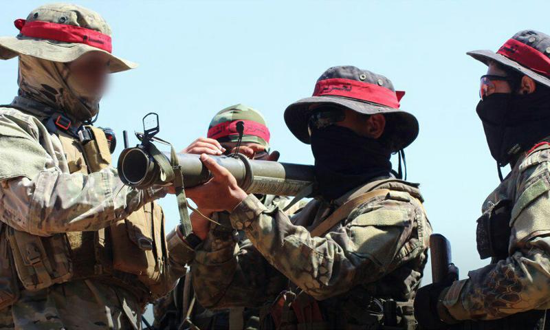 عناصر من أصحاب القبعاء الحمراء في هيئة تحرير الشام - آب 2018 (تحرير الشام)