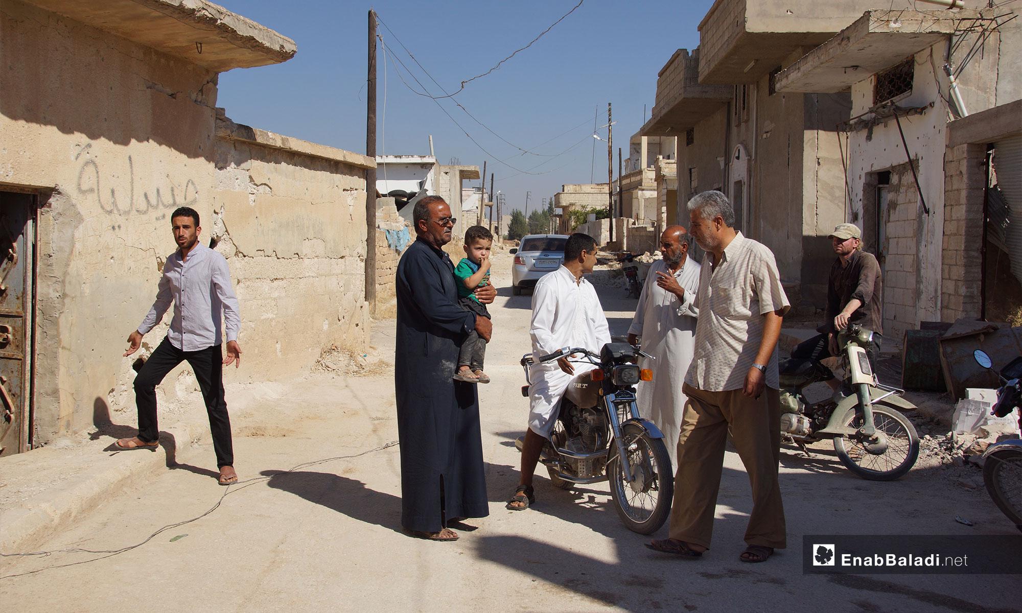 عودة الأهالي إلى مدينة اللطامنة وترميم منازلهم في ريف حماة الشمالي - 25 من أيلول 2018 (عنب بلدي)