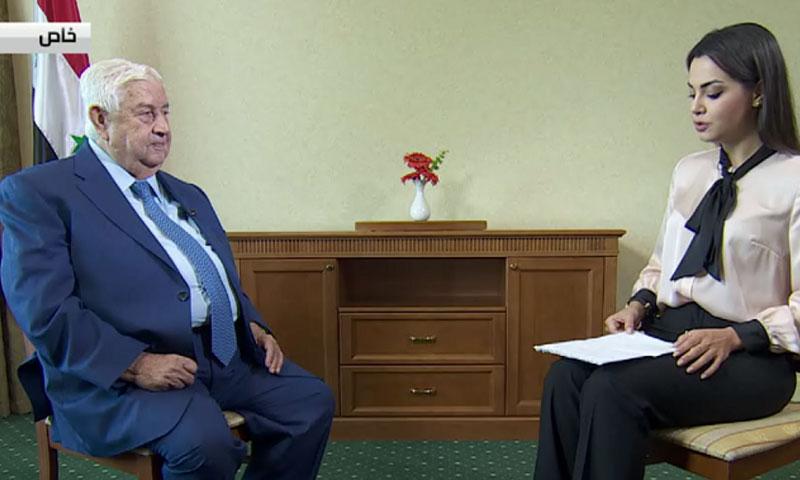 وزير الخارجية وليد المعلم في لقاء مع قناة روسية 1 أيلول 2018 (RT)