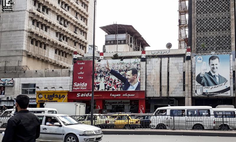 صور رئيس النظام السوري في شارع الثورة وسط دمشق - (عدسة شاب دمشقي)