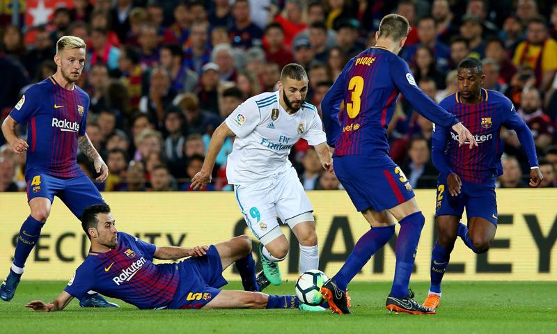 كلاسيكو العالم بين ريال مدريد وبرشلونة (رويترز)