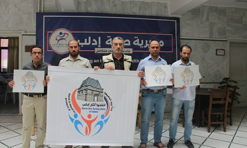 """وقفة للكوادر الطبية في إدلب تضامنًا مع حملة """"أنقذوا آثار إدلب""""- 9 تشرين الأول 2018 (مديرية صحة إدلب)"""