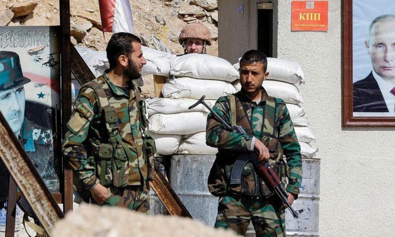 حاجز لقوات الأسد في الغوطة الشرقية (AFP)