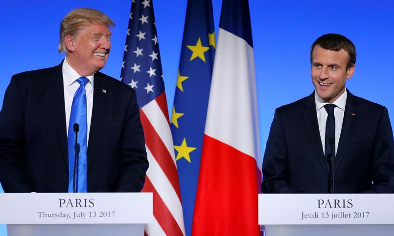 الرئيس الأمريكي دونالد ترامب، ونظيره الفرنسي إيمانويل ماكرون (رويترز)