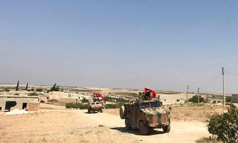 تسيير أول دورية مشتركة بين الجيشين التركي والأمريكي بمحيط مدينة منبج شمالي حلب 1 تشرين أول 2018 (الأناضول)