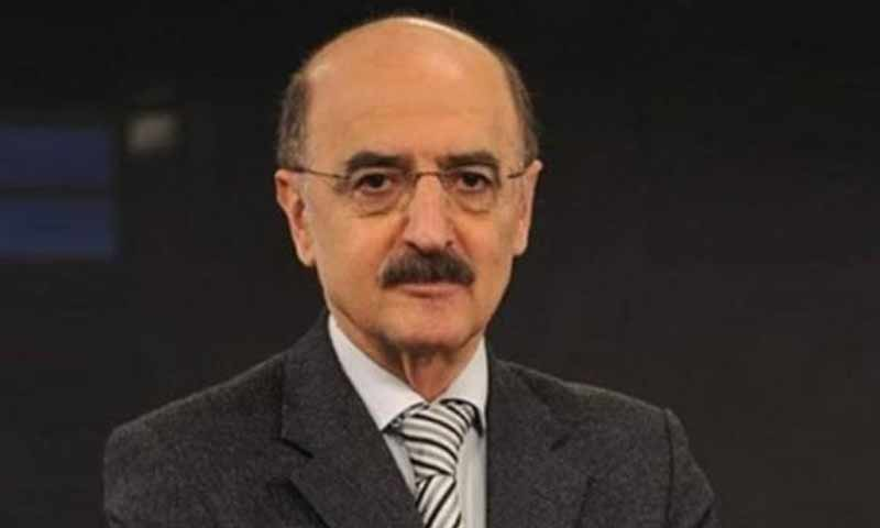 """مراسل وكالة الأنباء السورية """"سانا""""، حسني محلي (وكالة سانا)"""