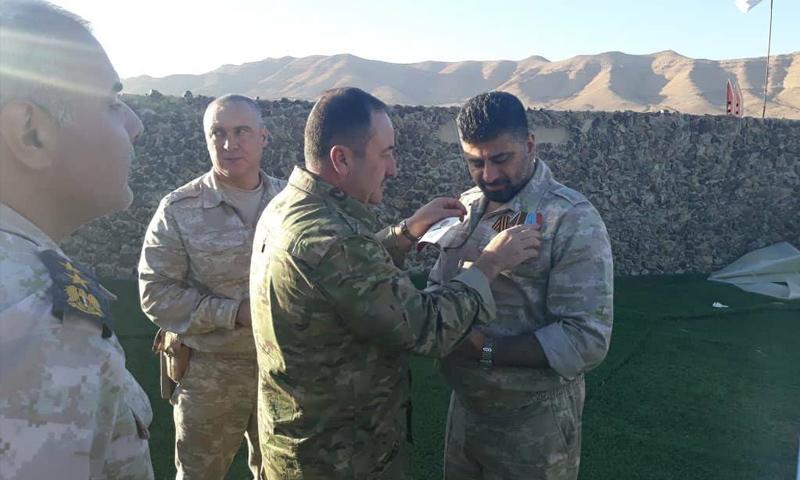 روسيا تكرم قائد ميليشيا حصن الوطن في تدمر - (حصن الوطن)