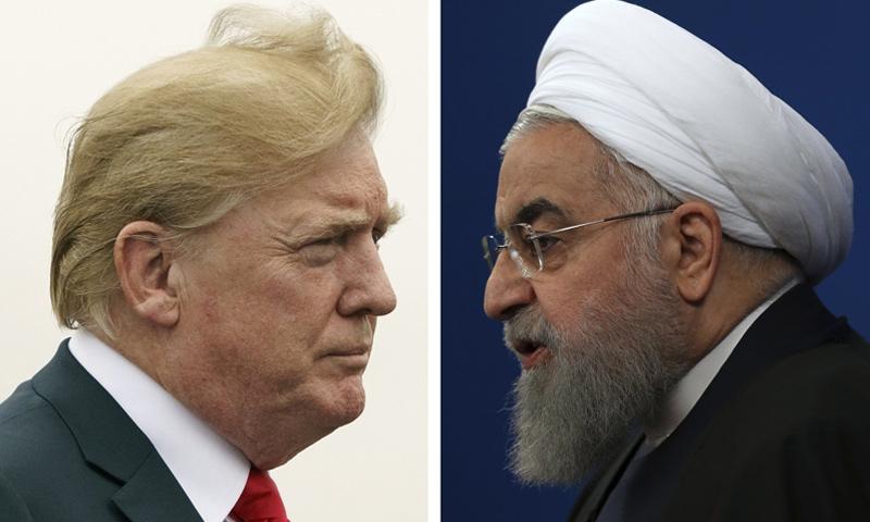 الرئيس الأمريكي دونالد ترامب ونظيره الإيراني حسن روحاني (AP)