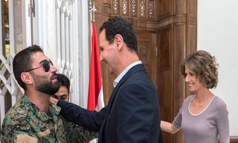 بشار الأسد يستقبل جرحى قوات الأسد(فيس بوك رئاسة الجمهورية)
