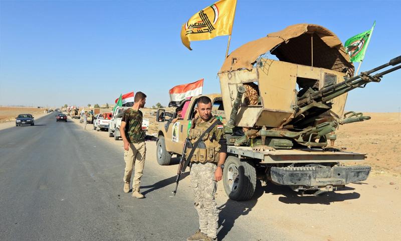 عناصر من الحشد الشعبي العراقي في أثناء العمليات ضد تنظيم الدولة في العراق - 2017 (رويترز)