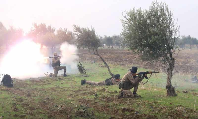 عناصر هيئة تحرير الشام أثناء تدريبات في الشمال السوري 2018 (وكالة إباء)