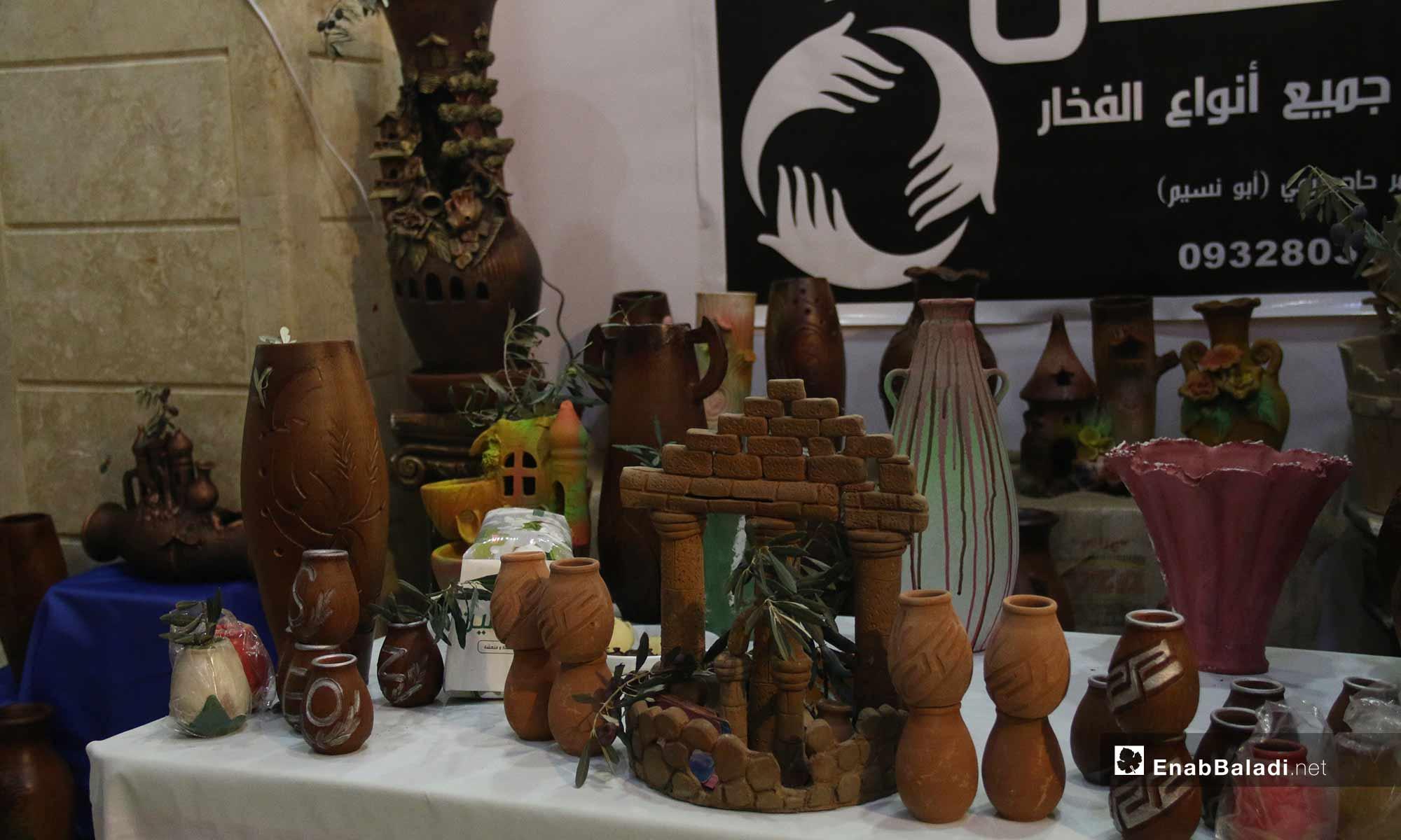 معرض لتسويق منتجات الزيتون في مدينة أرمناز بإدلب _ 15 من كانون الأول 2018 (عنب بلدي)