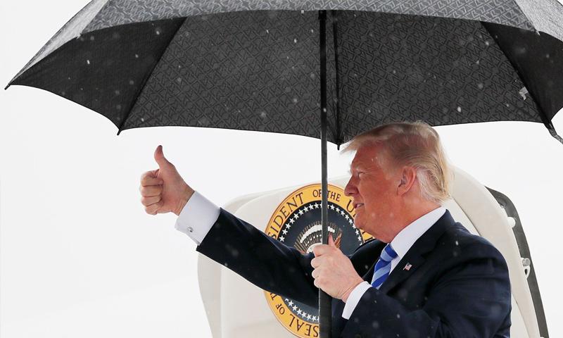 ترامب في أثناء وصوله إلى Dallas Love Field - 2018 (رويترز)