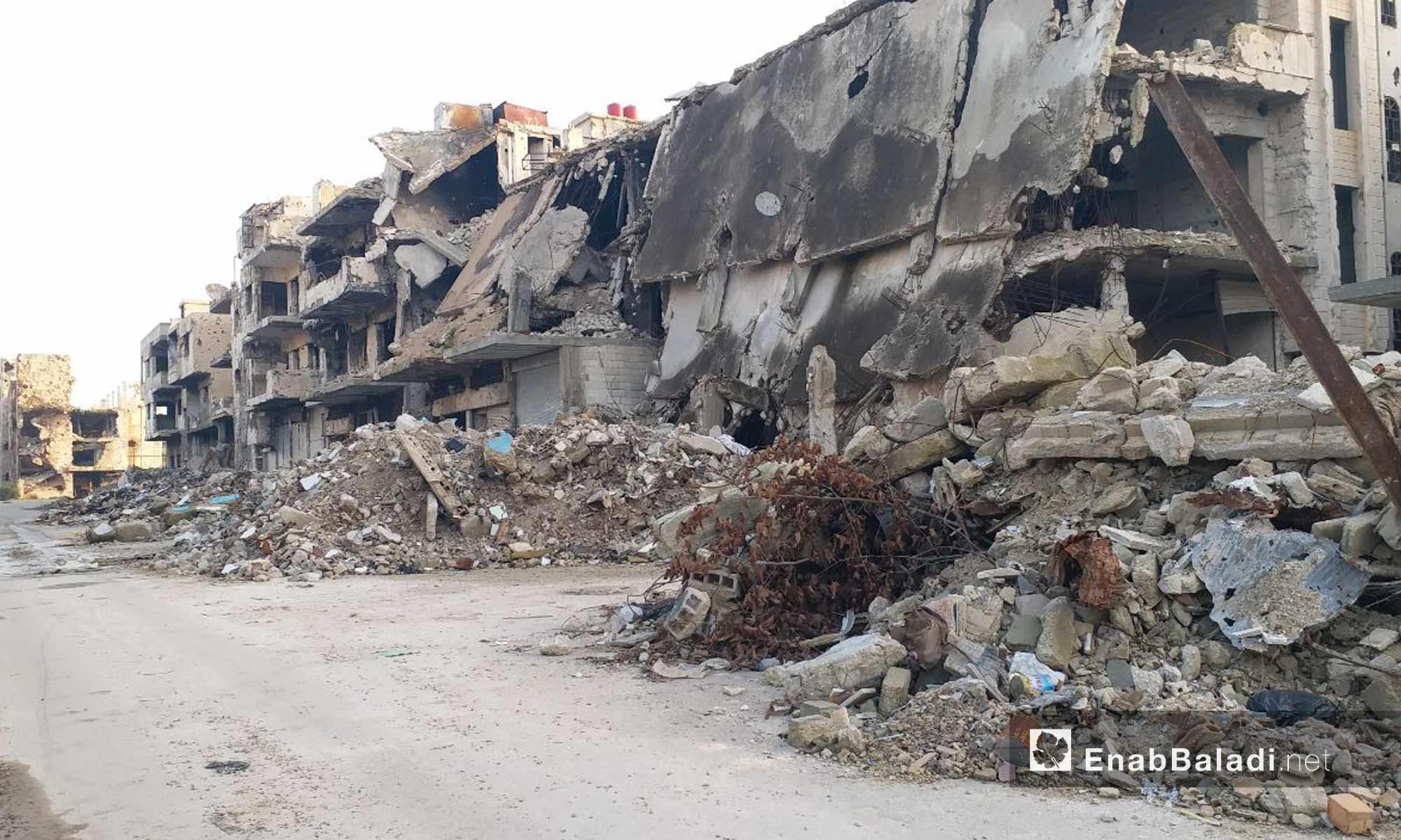 أبنية مهدمة في حي القصور في مدينة حمص - 24 من كانون الثاني 2019 (عنب بلدي)