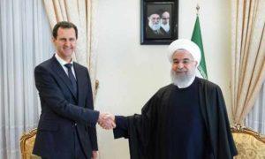 لقاء بشار الأسد والرئيس الإيراني حسن روحاني في طهران- 25 شباط 2019 (إرنا)