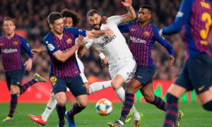 مواجهة ريال مدريد وبرشلونة في ذهاب كأس ملك إسبانيا (AFP)