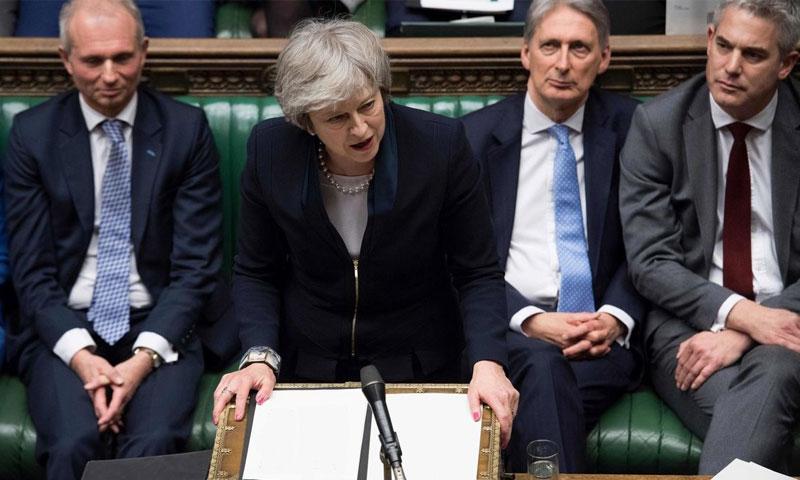 رئيسة الوزراء البريطانية تيريزا ماي متحدثة إلى مجلس العموم في لندن - 15 كانون الثاني (AFP)