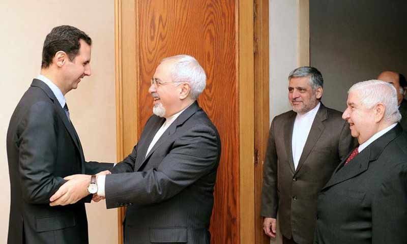 بشار الأسد ووزير الخارجية الإيراني جواد ظريف- كانون الثاني 2014 (كونا)
