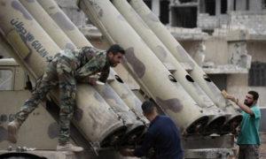 عناصر من قوات الأسد فوق راجمة صواريخ نوع جولان - 2018 (iarex)
