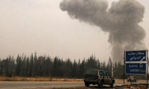 دخان يتصاعد جراء القصف عند الطريق المؤدي لمطار حلب الدولي- تشرين الأول 2016 - (رويترز)