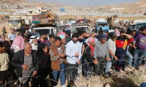 اللاجئون السوريين يستعدون للعودة من بلدة عرسال اللبنانية - 28 حزيران 2018 (رويترز)