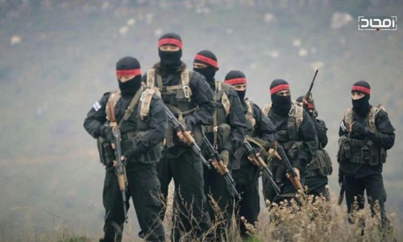 عناصر من العصائب الحمراء التابعة لهيئة تحرير الشام - (أمجاد)