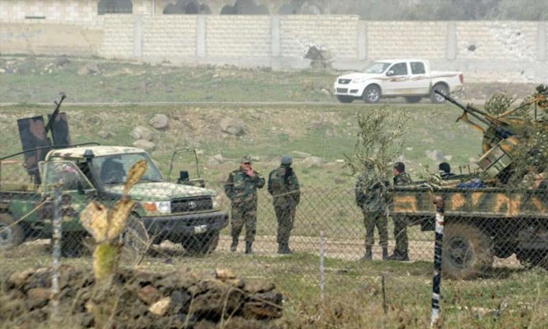 عناصر من قوات الأسد بعد السيطرة على منطقة دير العدس في درعا - 2015 (رويترز)