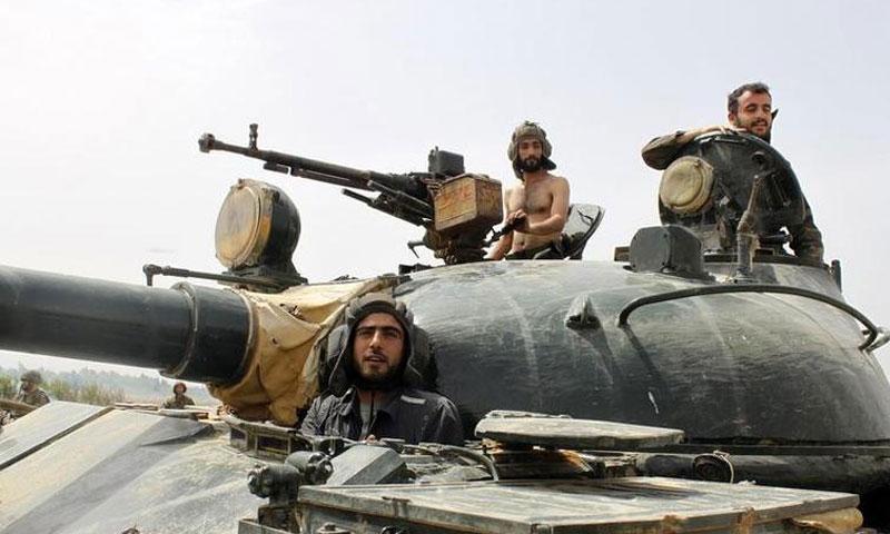 عناصر من قوات الأسد قرب قرية عرجون في ريف القصير - 2013 (رويترز)