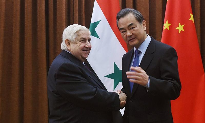وزيري خارجية الصين وسوريا وانغ تشاو ووليد المعلم - (AFP)