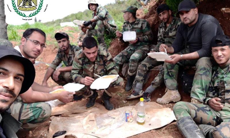 عناصر من جيش التحرير الفلسطيني وقوات الأسد على جبهات إدلب 7 أيار 2019 (جيش التحرير الفلسطيني)
