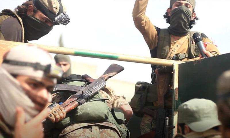 عناصر من هيئة تحرير الشام قبل معارك ريف حماة الشمالي - 7 من حزيران 2019 (وكالة إباء)