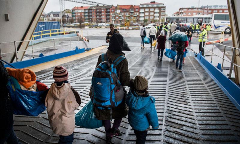 لاجئون سوريون في السويد عام 2015 (TT)