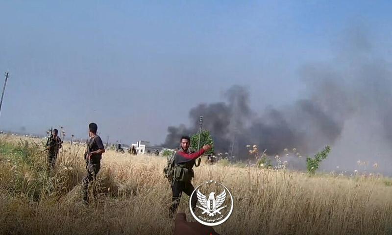 عناصر من الجبهة الوطنية للتحرير على جبهات تل ملح والجبين في ريف حماة الشمالي - حزيران 2019 (الجبهة الوطنية)