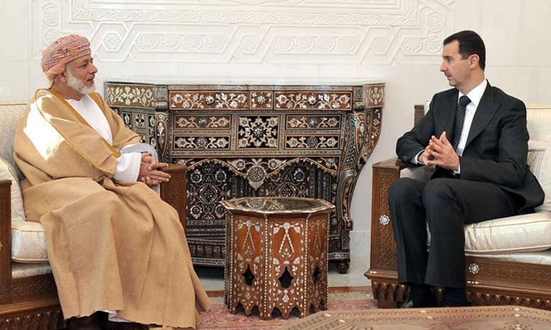 رئيس النظام السوري بشار الأسد وزير الخارجية العماني يوسف بن علوي (AFP)