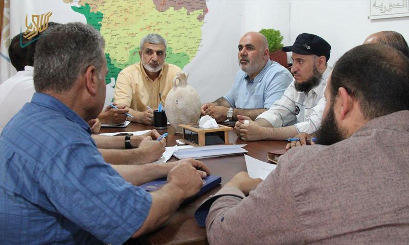 مسؤولون في حكومة الإنقاذ خلال اجتماع تشكيل لجنة عمل للحفاظ على الآثار في إدلب - 15 من تموز 2019 (حكومة الإنقاذ)