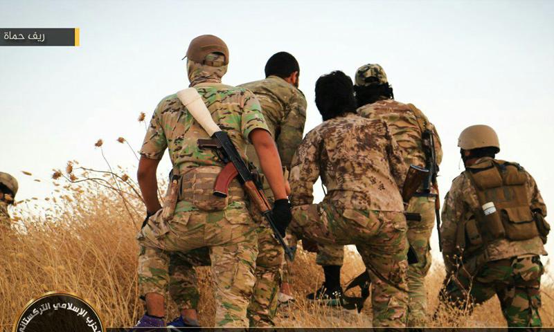 عناصر من الحزب التركستاني على جبهات ريف حماة الغربي- (صوت الإسلام)