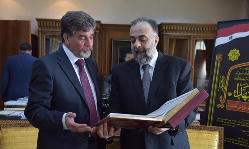 وزير الأوقاف محمد عبد الستار السيد وأنور عبد الهادي - (الصفحة الرسمية لوزارة الأوقاف السورية)