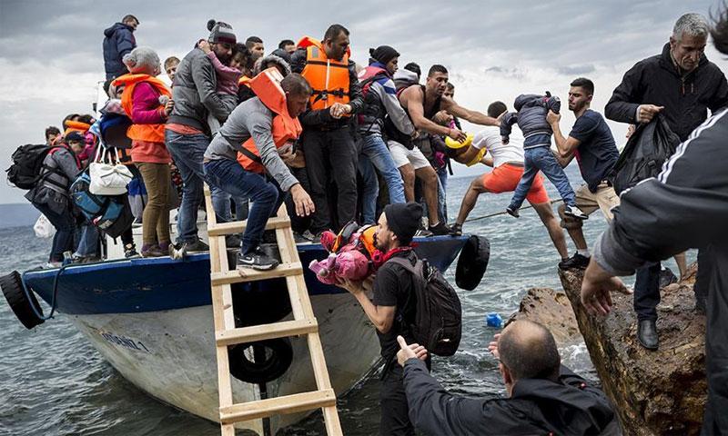 لاجئون سوريون وصلوا إلى اليونان من تركيا - 11 تشرين الأول 2015 (هيومن رايتس ووتش)