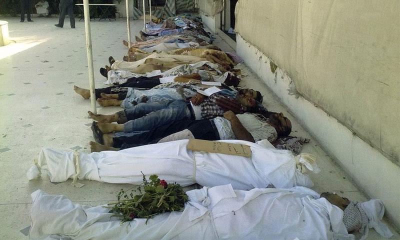 ضحايا في مجزرة داريا - آب 2012 (شبكة شام الإخبارية)