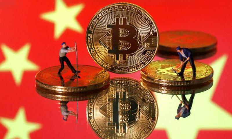 عملة الصين الرقمية (BRENDA GOH AND ALUN JOHN)