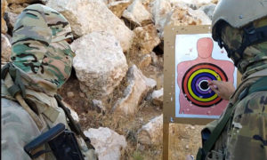مقاتلون من مجموعة ملحمة تاكتيكال في أثتاء إجراء تدريبات قتالية في ريف إدلب - 24 من أبلول 2019 (ملحمة تاكتيكال عبر تلغرام)