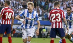 اللاعب النرويجي مارتن أوديغارد يحتفل بتسجيله هدف في شباك أتلتيكو مدريد (Javi Colmenero)