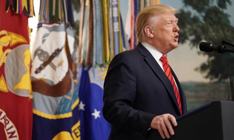 الرئيس الأمريكي دونالد ترامب في مؤتمر صحفي يعلن فيه مقتل أبو بكر البغدادي (رويترز)