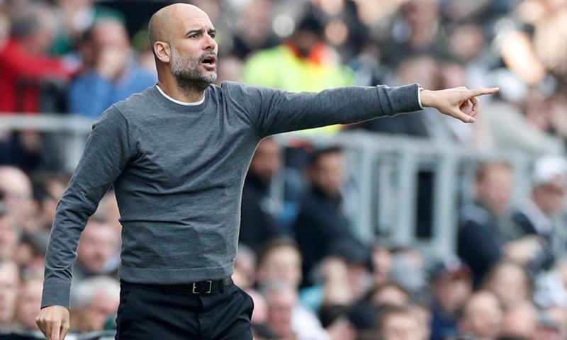 مدرب نادي برشلونة ومانشستر سيتي الحالي، بيب غوارديولا (رويترز)