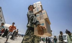 توزيع المساعدات على أهالي مخيم الهول في الحسكة - تموز 2019 (UNICEF)