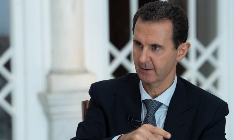 رئيس النظام السوري، بشار الأسد، في مقابلة تلفزيونية (الإخبارية)
