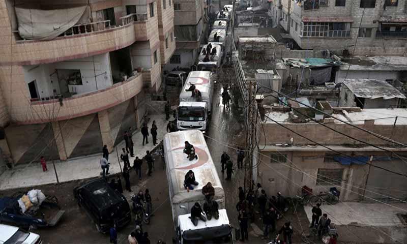 إيصال المساعدات الأممية عبر الحدود التركية نحو إدلب - 2019 (AFP)