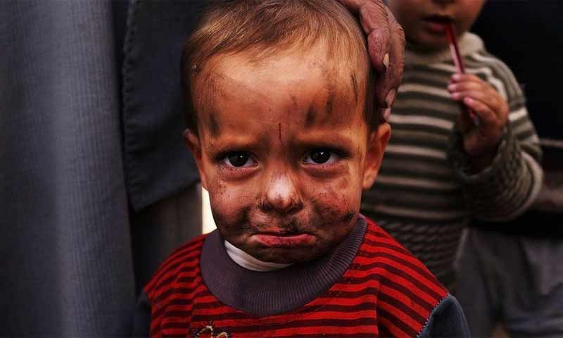 طفل سوري في مخيم للنازحين (Getty)
